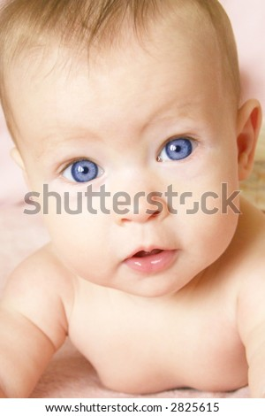 Little Baby Girl closeup with blue eyes