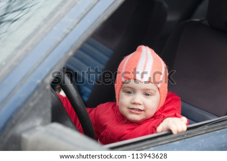Little baby girl driving  car vehicle
