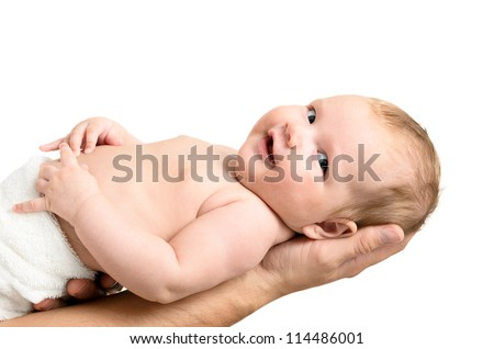 Little baby girl held carefully by father's hands, isolated on white background