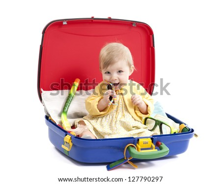 little baby girl in a suitcase, isolated on white background