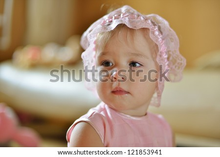 little baby girl looking left
