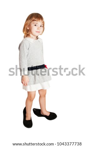 e2194bdd772bb Little baby girl wearing big shoes. Isolated on white background.  #1043377738