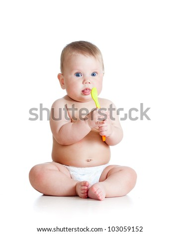 Little baby girl with a spoon