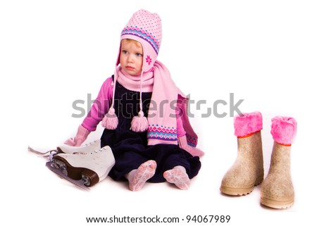 Little baby girl with figure skates over white background