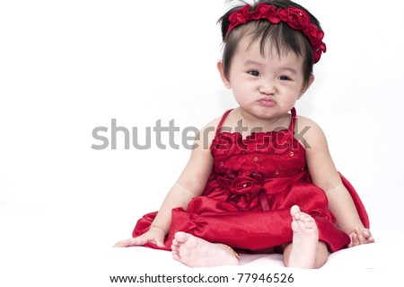 Little baby girl with funny expression - stock photo