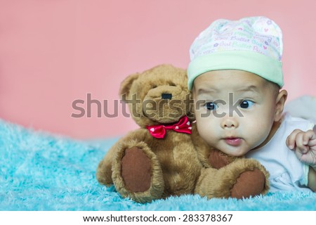 Little baby girl with teddy