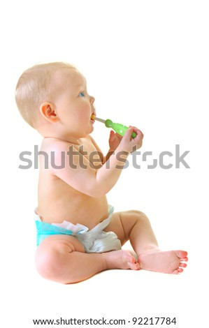 Little baby girl with teething brush isolated on white