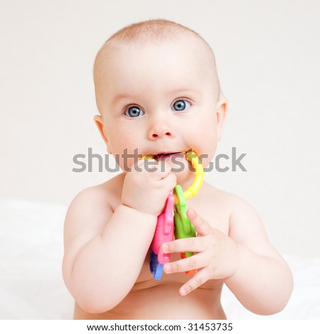 Little baby girl with teething toy