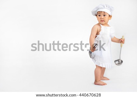 077059c3a7e little baby in a chef s hat and ladle in hand  440670628