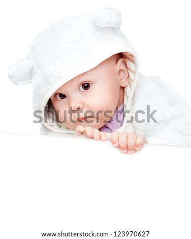 little baby in white bear costume isolated on white background with empty white board