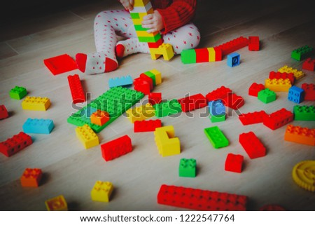 little baby playing with colorful plastic blocks #1222547764