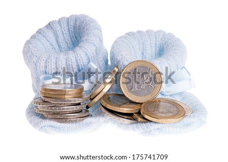 little baby shoes and euro coins isolated over a white background / Expenses for a child