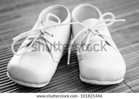 Little Baby Shoes  on a wooden background, black and white