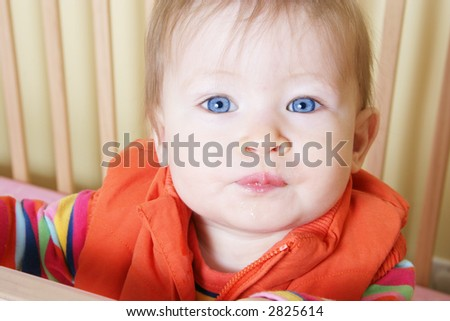 Little Baby standing in Crib - Closeup of Face