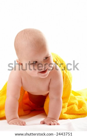 Little baby under yellow towel