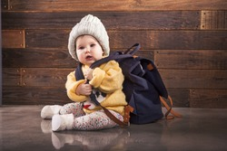 Little baby with backpack is ready for traveling