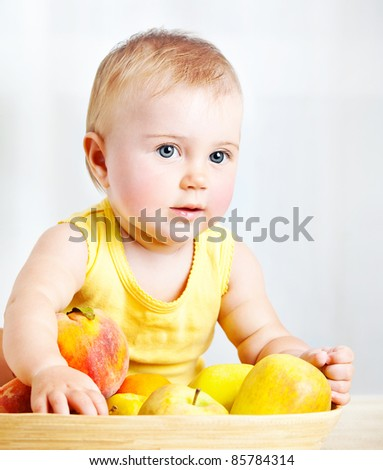 Little baby with fruits, closeup portrait, concept of health care & healthy child nutrition