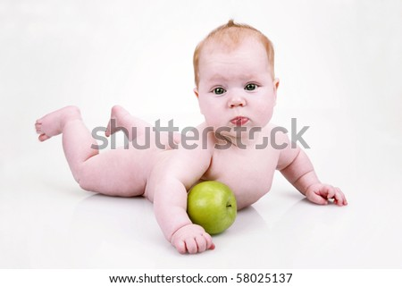 Little baby with green apple