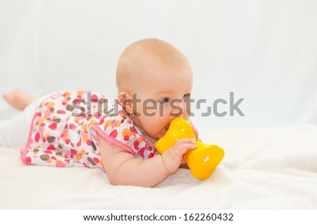 little baby with her toy