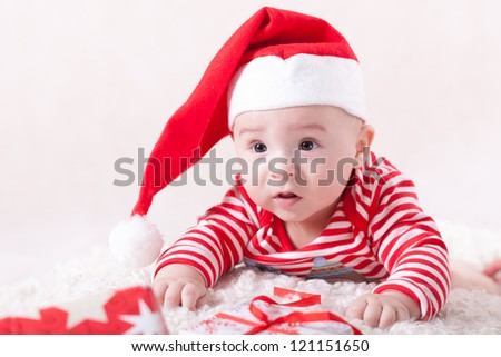 Little baby with santa's cap and presents