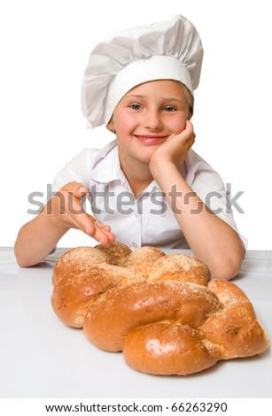 Little baker girl with twist bread loaf