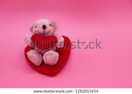 Little bear delivers a red heart on Valentine's Day , Give love and concern on pink black ground wallpaper Textures close up  isolated #1282015654