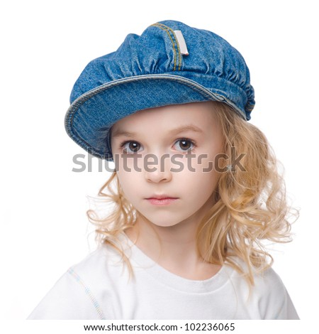 Little beautiful blond girl with curly hair in jeans cap isolated on white background