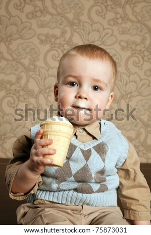 little beautiful boy eats icecream