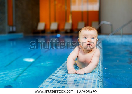 little beautiful boy in the pool. prevention of diseases of the musculoskeletal system.  health