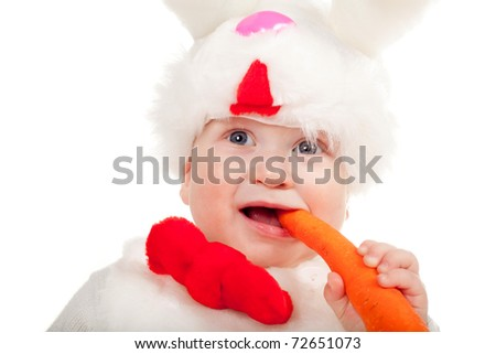 little beautiful boy with carrot in rabbit costume