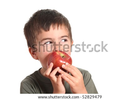 little beautiful child playing and eating an apple - isolated on white