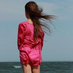 Little beautiful girl enjoy her life under  the sun over sea beach, East Crimea, Russia