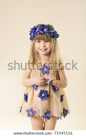Little beautiful girl in blue garland