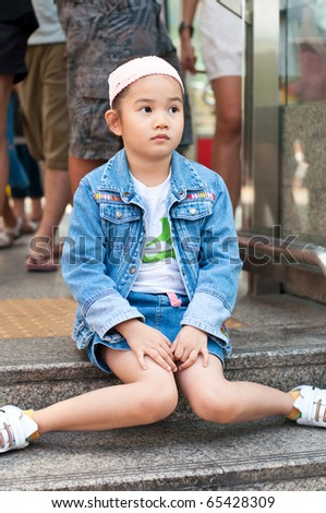 Little beautiful girl, she is waiting, Thailand.