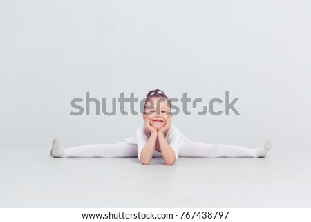 e83770784 Free photos Gymnast cute little girl sitting on the floor. The child ...