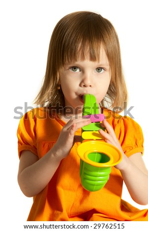 Little beauty girl with toy saxophone in her hands on white background. - stock photo