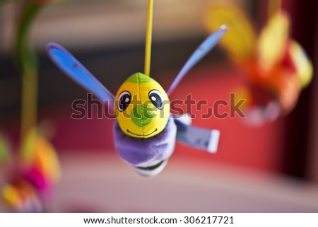 Little bee hanging above baby bed. Joust. Toys for babies