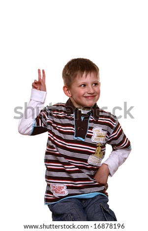 Little blond boy eager to answer a question, two fingers raised