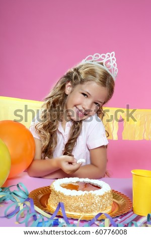 little blond girl in birthday party eating cake