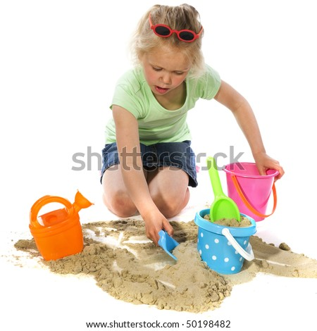 Little blond girl is playing with sand