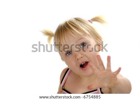 Little  blond girl looking up getting her dream with open palm isolated on white