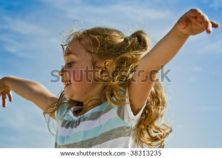 Little Blond Girl Pretending to Fly