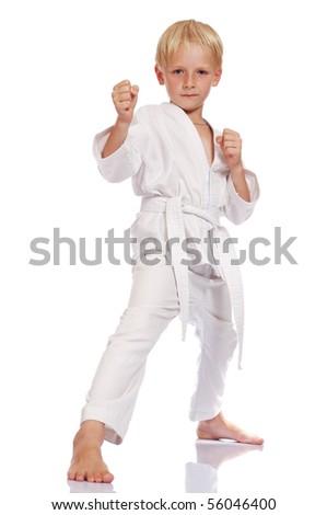 little blonde boy dress karate uniform isolated on white