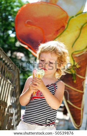stock-photo-little-blonde-girl-looking-with-gladness-at-the-big-ice-cream-50539876.jpg
