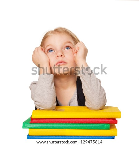 Little bored student girl with books. Child looking up. Isolated on white background