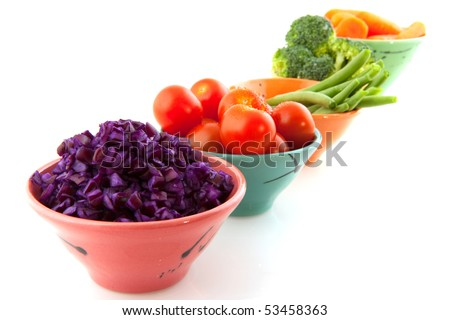 Little bowls with fresh vegetables on white background