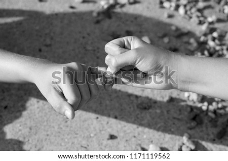 Little boy and girl hand fingers make peace trust sign movement after fight.Friendship and peace concept
