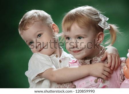 little boy and girl hugging - stock photo