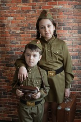 Little boy and girl in military uniform at the May 9 celebration in Russia, Victory Day.