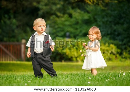 Little boy and girl in the park